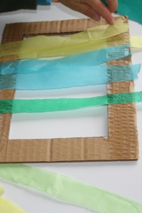 Glue tissue paper across frame