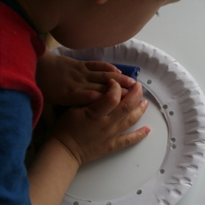 Punching holes round centre of plate