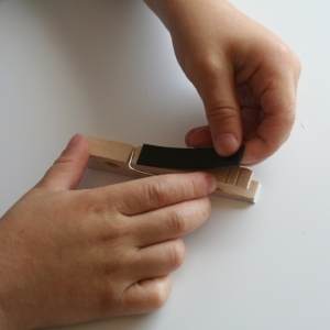Sticking magnetic strip onto peg