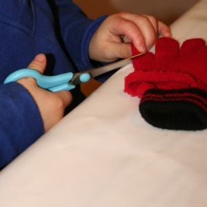 Cutting end off woolly glove for hat