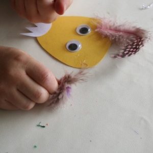 Sticking on Dragon's eyes, nose, teeth and feathers